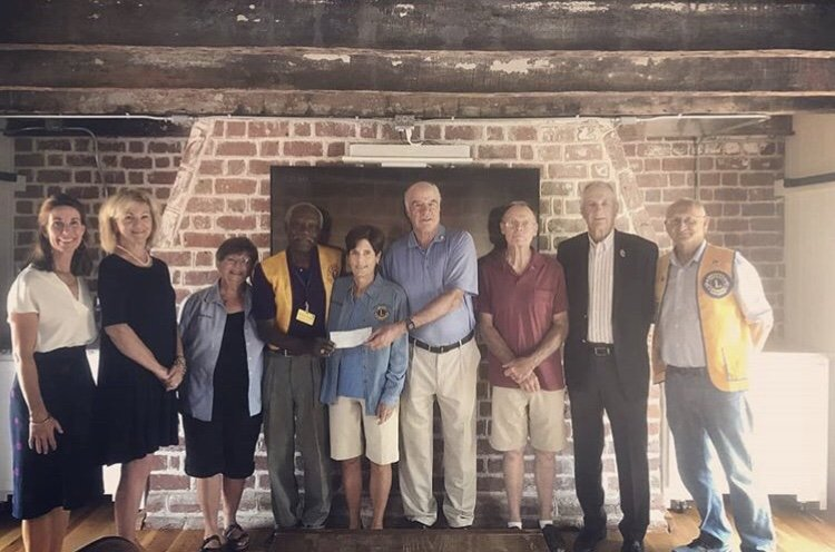 Lions present check to Barrier Island Center