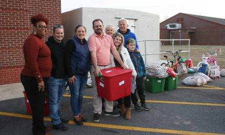 Two couples make Christmas brighter for E. S. Boys and  Girls Club members