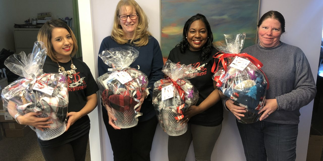 Red Door Empowerment gives baskets to ESCADV on Christmas